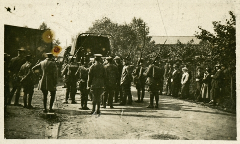 The captured crew of Zeppelin L33, about to be marched into captivity by local home defence troops, while the people of Little Wigborough look on